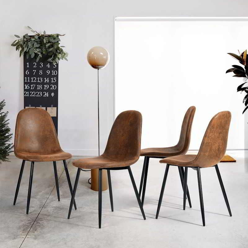 Sillas tapizadas en cuero sintético para salón de estilo industrial.